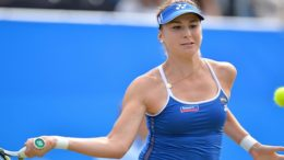 Switzerland's Belinda Bencic returns the ball during her women's semi-final match against Denmark's Caroline Wozniacki at the WTA Eastbourne International tennis tournament in Eastbourne, southern England on June 26, 2015. Wozniacki withdrew from the match meaning Bencic won 3-0.   AFP PHOTO / GLYN KIRK