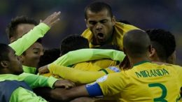 Brazil's Thiago Silva, center, is congratulated bu his teammates after score against Venezuela  during a Copa America Group C soccer match at the Monumental stadium in Santiago, Chile, Sunday, June 21, 2015. (AP Photo/Jorge Saenz)